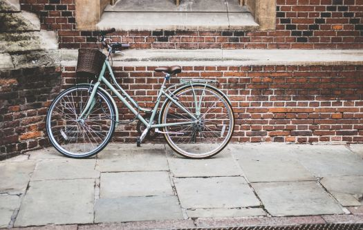 Bike leaning against the wall in Cambridge